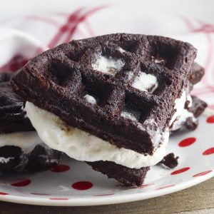 homemade brownie ice cream waffle sandwiches on a white plate with red polka dots