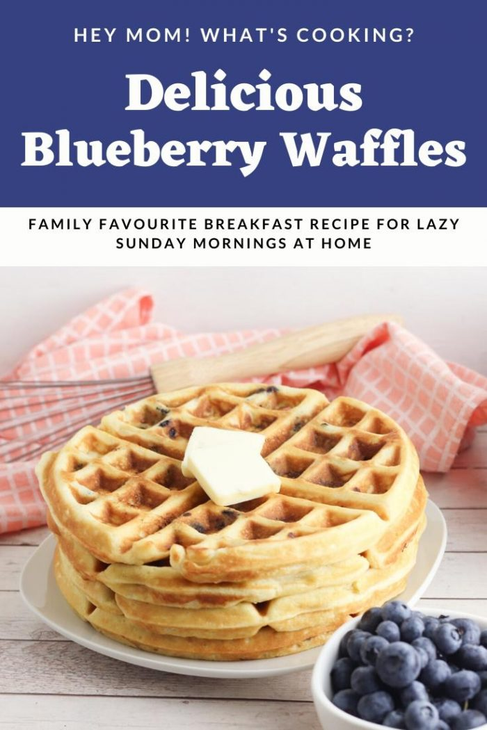 waffles filled with fresh blueberries on a white plate with a bowl of fresh blueberries in front