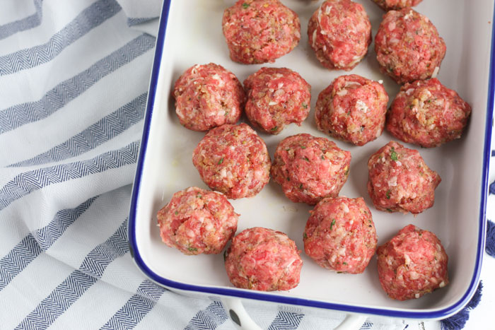 round meatballs ready to go in the oven
