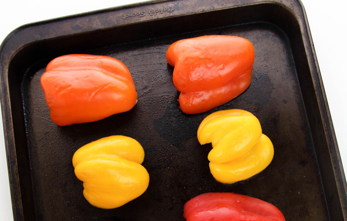 peppers placed on a baking tray ready to cook
